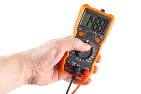 digit 1488 on lcd screen of digital electrical multimeter in left hand, isolated on white background