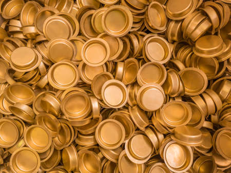 pile of stamped thin sheet brass hat-shaped semimanufatures