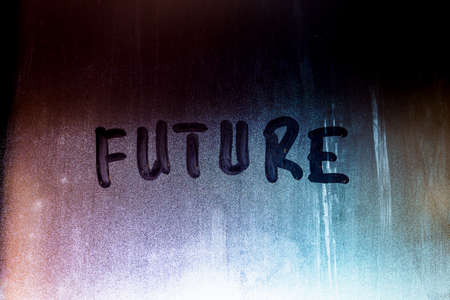 word future handwritten on night foggy window glass surface