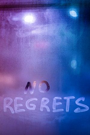 words no regrets hand written on purple-blue night foggy window glass 版權商用圖片