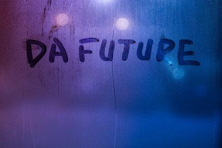 words da future handwritten on night foggy window glass surface
