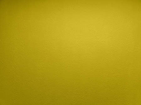 abstract yellow plaster wall flat full frame background