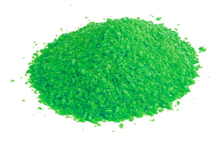 pile of dry green chemical granules - close-up isolated on white background
