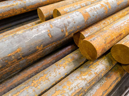 rusted long round steel bars pack - close-up with selective focus