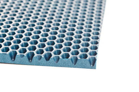 blue hexagonal punched - ethylene vinyl acetate foam carpet linear perspective background with selective focus