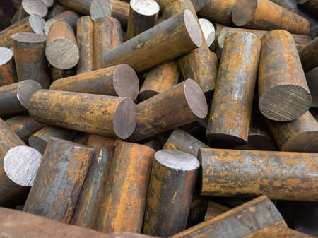 a pile of raw steel short rods cutted by saw- workpieces prepaired for forging, close-up with selective focus 版權商用圖片