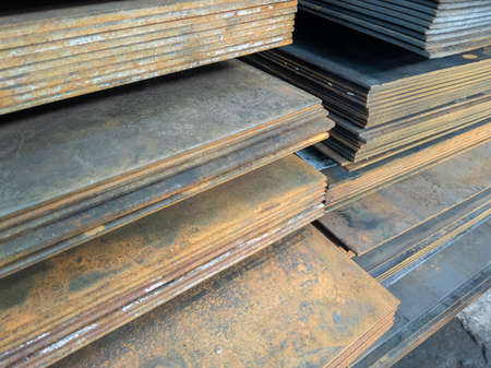 stacks of thick rusted flat metal sheets - close-up