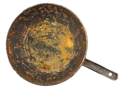 old disgusting stained rusty cast iron pan with burnt fat and food leftovers isolated in directly above perspective