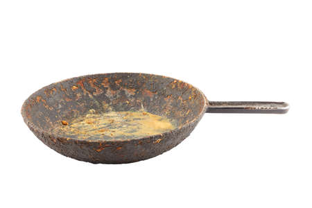 old disgusting stained rusty cast iron pan with burnt fat and food leftovers isolated