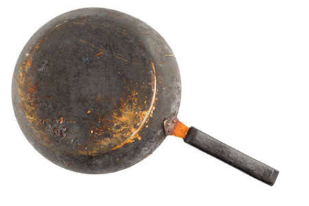 old stained rusty cast iron pan with burnt fat isolated on white bottom up in flat lay perspective