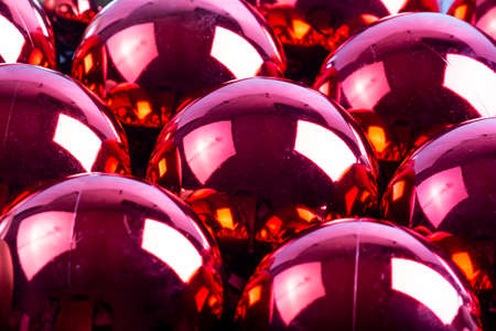 full frame background of red mirror balls close-up with selective focus Фото со стока
