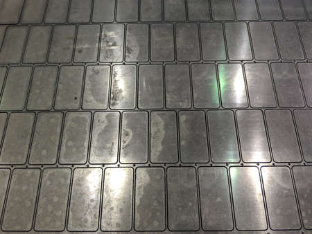 full frame background of waterjet cutted parts in steel sheet Фото со стока