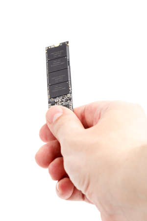 caucasian hand holding NVME M.2 SSD 2280 3Dnand SLC drive stick isolated on white