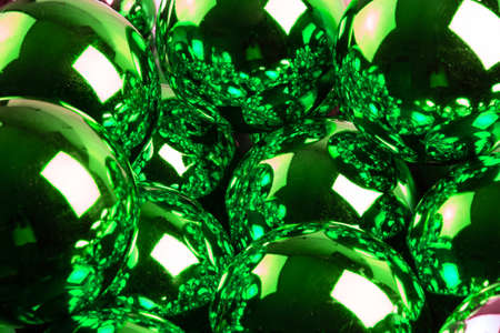 full frame background of green mirror balls close-up with selective focus Фото со стока