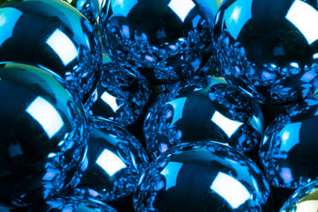 full frame background of blue mirror balls close-up with selective focus