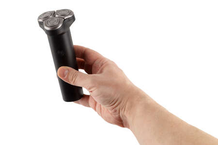 bare caucasican hand holding three razor black electric shaver - isolated