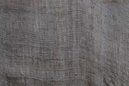 old dry grey rag drying outdoors - close-up background and texture