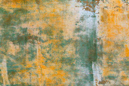 shabby weathered artistically peeled off yellow and green paint Banque d'images