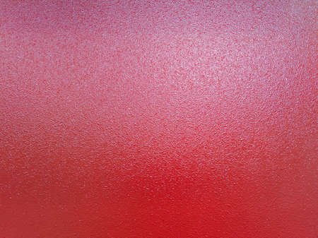 background of red shagreen powder paint coating on flat sheet steel surface Stock Photo