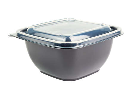 Black opaque single-use PET - Polyethylene terephthalate -plastic food take-out container with tranparent cover, isolated.