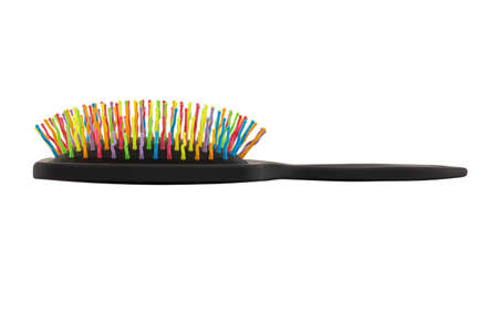 new rainbow colorful pastic hair brush isolated on white background