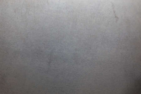 Uncoated flat cold rolled steel sheet surface with few minor scratches. Close-up in directly above composition. Stock Photo