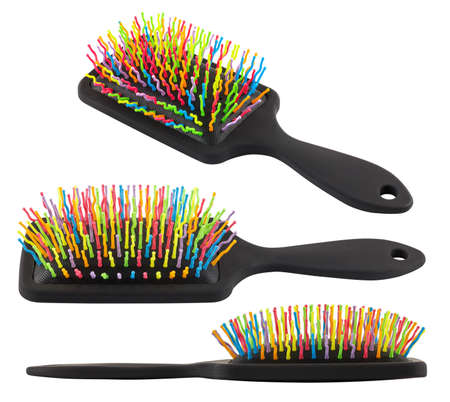 set of different views on new rainbow colorful pastic hair brush isolated on white background