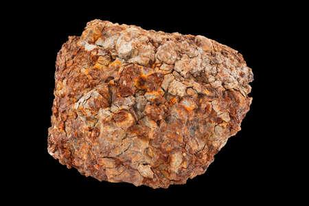 large piece of metallurgical ferrous iron stone ore isolated on black background