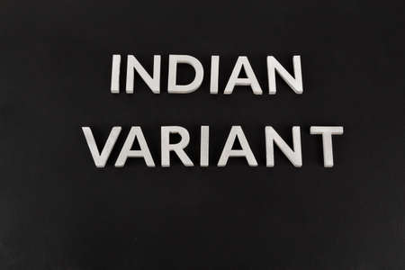 words indian variant laid with silver metal letters on flat matte black surface Stock Photo