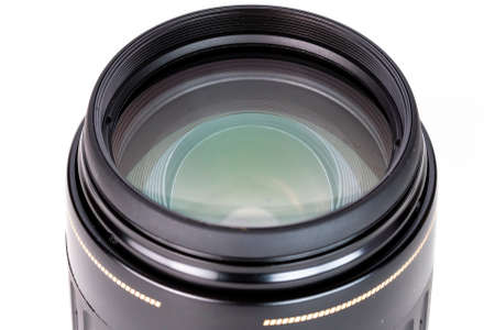 close-up view on old dslr telephoto lens on white background