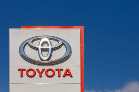 Toyota logo on promotional stand at sunny day - Toyota Motor Corporation is a Japanese automotive manufacturer. Sajtókép