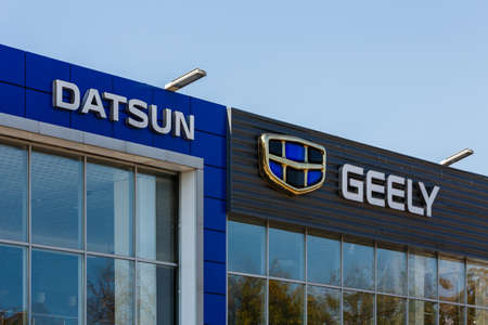 Datsun and Geely logos on car dealership buildings at sunny day - Datsun is an automobile brand by Nissan Company, Geely is big Chinese manufacturer