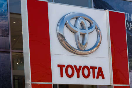 Toyota logo on car dealership building at sunny day - Toyota Motor Corporation is a Japanese automotive manufacturer.