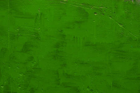 carelessly painted green flat surface - texture and full frame background