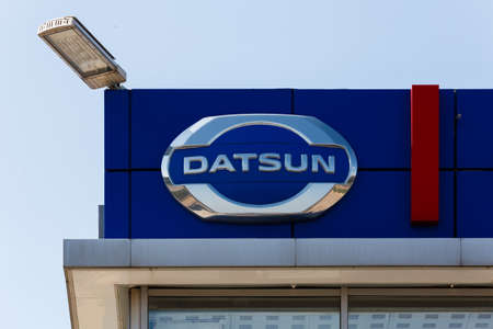 Datsun logo on car dealership building at sunny day - Datsun is an automobile brand owned by the Nissan Motor Company