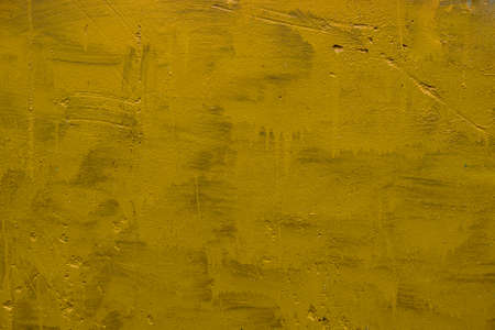 carelessly painted yellow flat surface - texture and full frame background