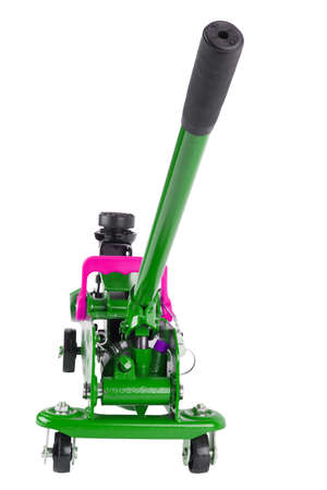 green hydraulic car jack isolated on white background, lowered