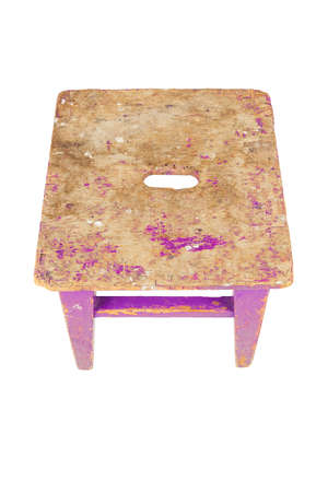 Old wooden stool with peeling pink paint. Loft style chair isolated on a white background. Stock fotó