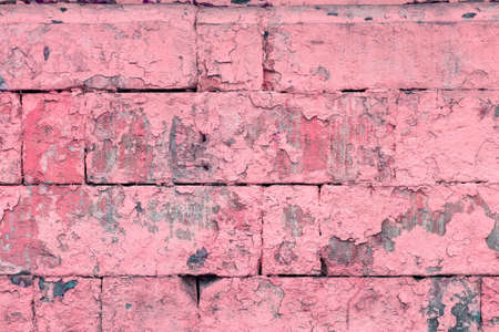 peeled off old pink paint on flat rough brick wall surface - full frame background and texture Stock fotó