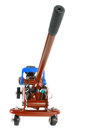 red hydraulic car jack isolated on white background, lowered