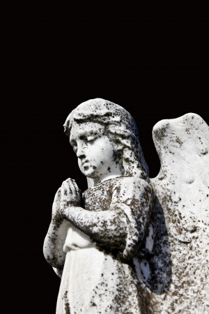 angel cemetery: Angel pray statue on tombstone , cemetery graveyard Isolated Black  Stock Photo