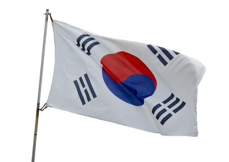 Japanese flag flying on a white background.