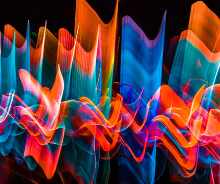 Abstract wavy and horizontal color lights in motion.