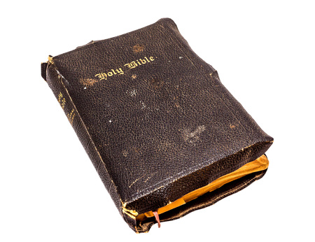 Old Christian Bible on a white background.