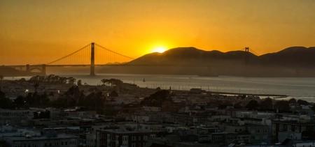 Golden Gate Bridge at sunset with sun just below the horizon.