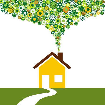 Maison écologique et des fleurs au lieu de la fumée de la cheminée