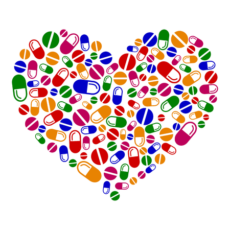 Heart of pills and capsules isolated on white background