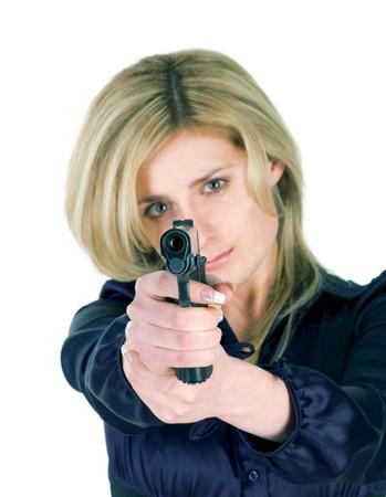 Beautiful blond girl aiming a gun at camera photo
