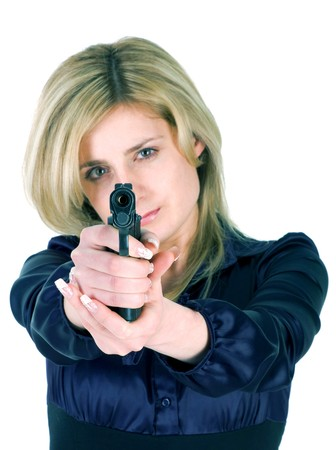 Beautiful blond girl aiming a gun at camera