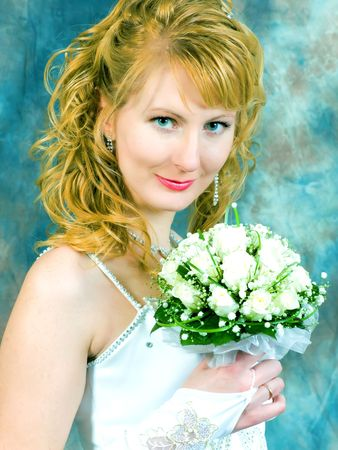 portrait of bride with flowers in her hand photo